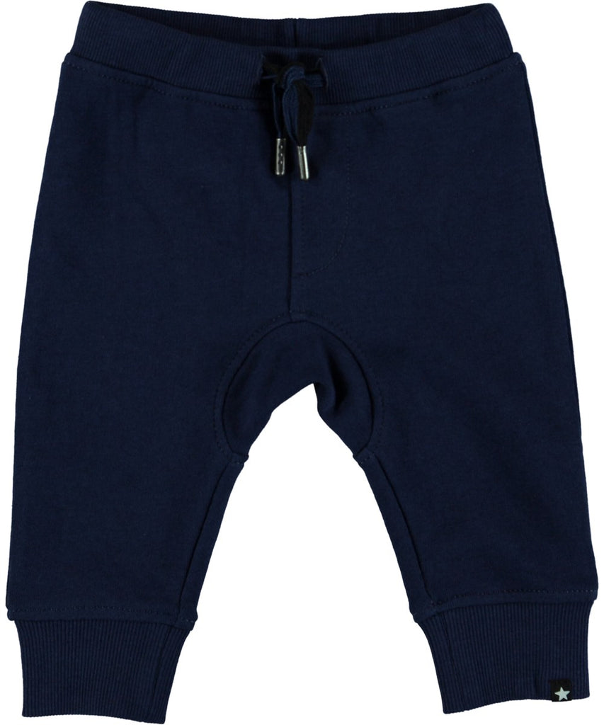 Molo Stan Pants in the color Sailor.  These navy blue pants have a dropped crouch and tie at the waist. These pants are made from certified organic cotton.