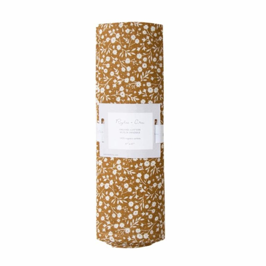 Rylee and Cru swaddle is made from organic cotton. The marigold color with with an all over floral print makes it a great gift for an expectant mom.  A stylish swaddle that mom can wear as a scarf or use as a coverup during breast feeding. This swaddle can also be used as a tapestry for baby's nursery. The gender neutral colors makes this a unique baby shower gift.