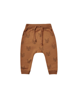 """Relaxed fit sweatpants made of the coziest french terry fleece, featuring an allover print. These sweatpants include an elastic waistband with drawstring, pockets, and rib knit at bottom leg openings.  Featuring our 'fox' all-over print on cinnamon.  Care: Machine wash cold. Tumble dry low.  Made of 60% cotton, 40% polyester"""