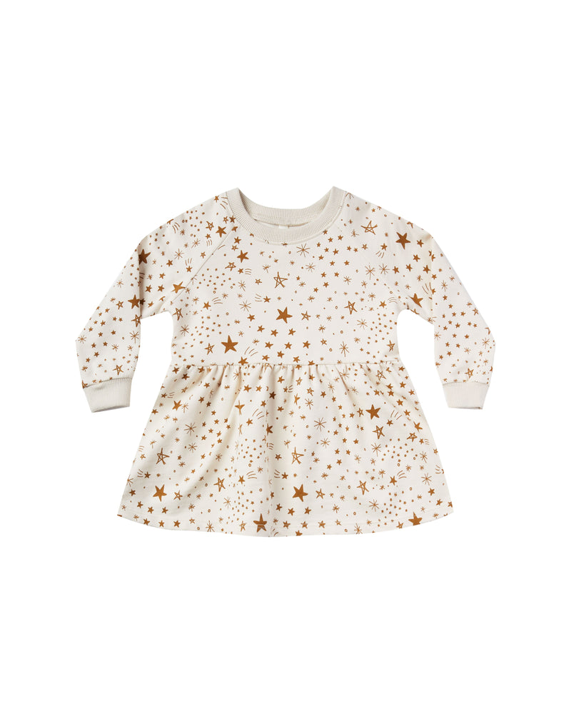 """Longsleeve raglan sweatshirt dress featuring an all-over print. Easy pullover style with rib bads at sleeve openings and neckline, and a gathered skirt.   Featuring our 'starburst' all-over print on natural  Care: Machine wash cold. Tumble dry low.  Made of 60% cotton, 40% polyester"""