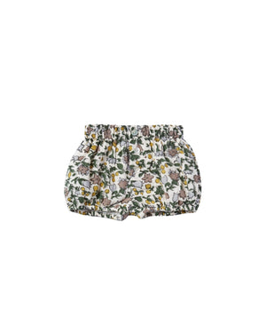 Woven shorts featuring three buttons on the front. Elastic waistband and leg openings create a bubble silhouette easy for changing. Fully lined for the highest quality.  Featuring our enchanted garden all-over print on ivory.  Care: Machine wash cold. Tumble Dry low. Minor shrinkage may occur if tumble dried.  Made of 100% cotton