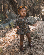 Rylee + Cru baby bubble romper featuring an elasticized neck opening, sleeve openings, and leg openings to create a bubble-like silhouette. Snaps at bottom opening.  Color: vintage black floral  Care: Machine wash cold. Tumble dry low.  Made of 100% viscose