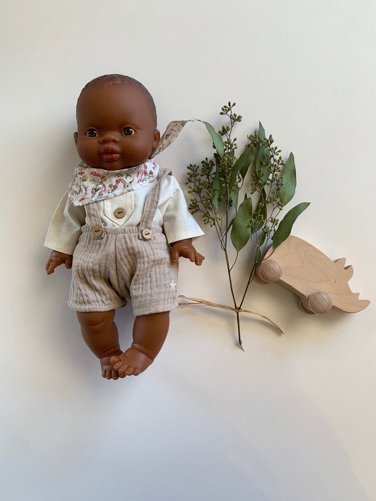 Minikane African male doll has brown eyes and is made from eco-friendly non-toxic vinyl in the Alicante valley in Spain.