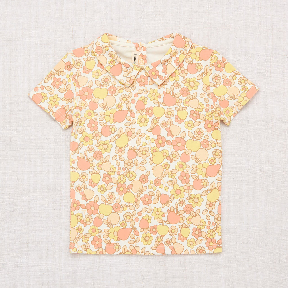 Misha + Puff sunflower orchard print tee. Featuring a collar and snap in the back.   100% Pima Cotton