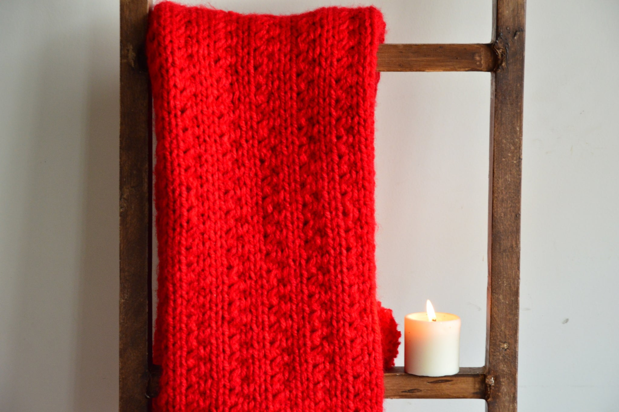 Red Scarf with Pom Poms | Woven Stories