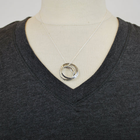Necklace falls right above the v-neck line of a t-shirt