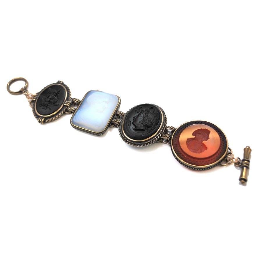 bracelet has 3 cameos and one red intaglio.
