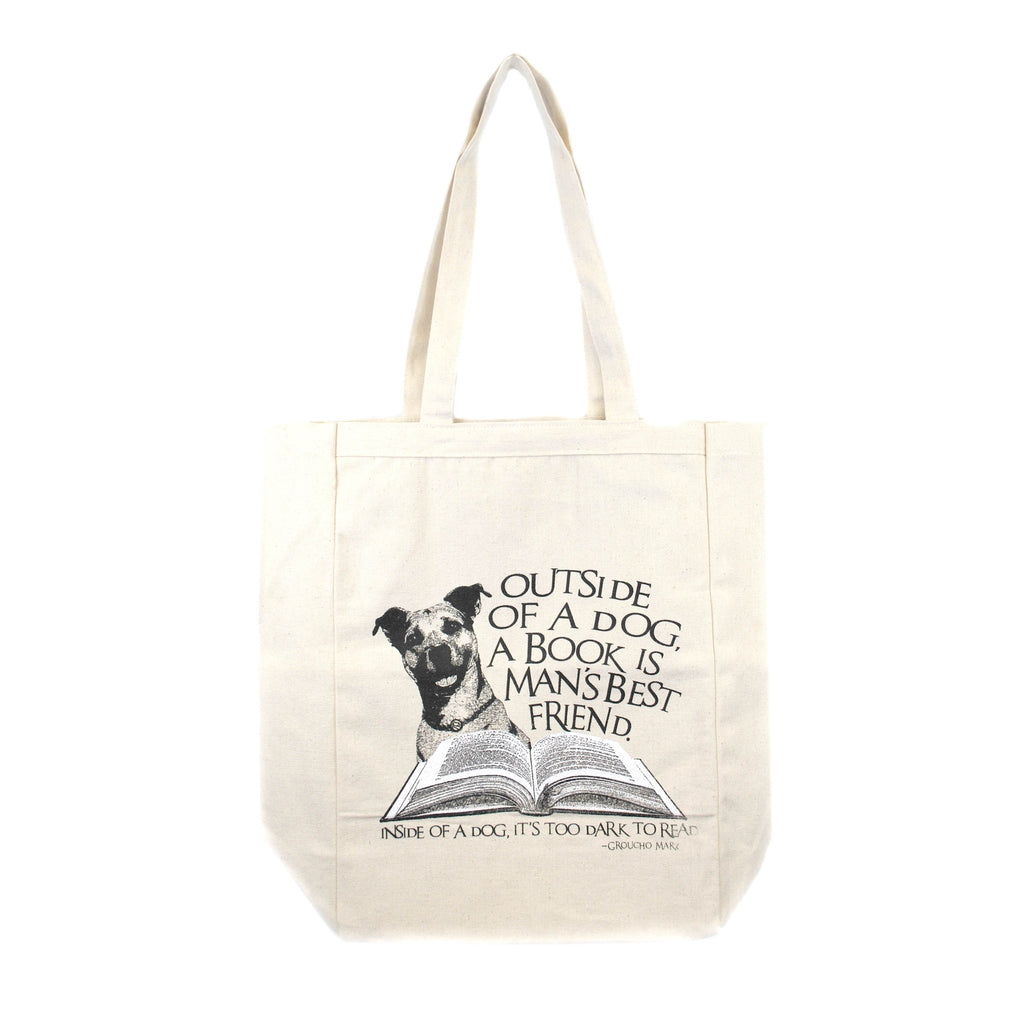 Illustration of a dog and a book on a light beige background tote with quote on the side.