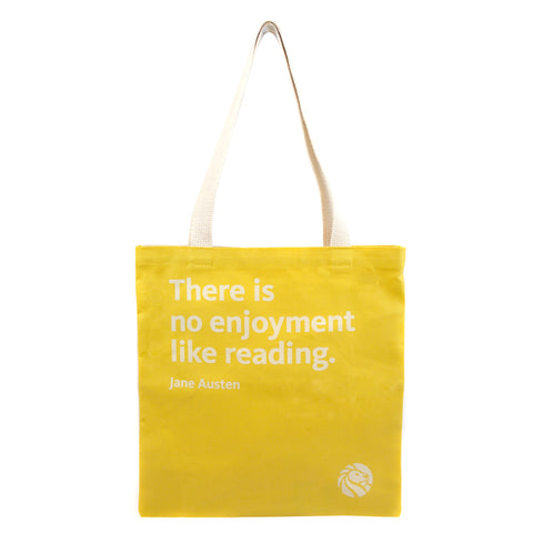 Quote on mustard background tote bag with cream colored handles.
