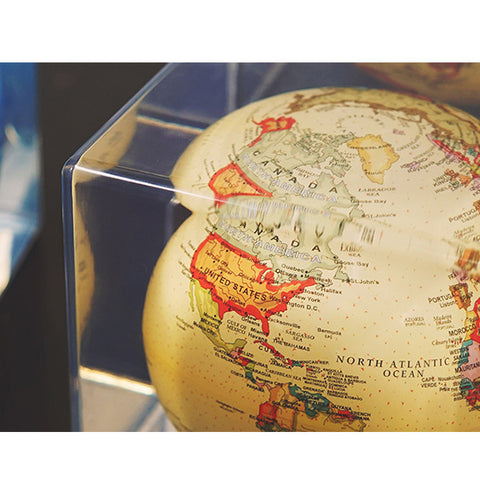 Globe is floating inside a cube.