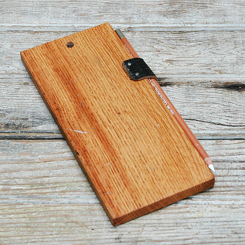Reverse is wooden. Brown color.