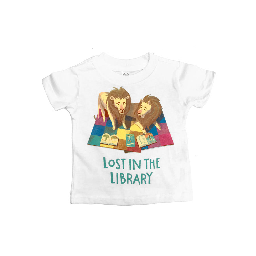 "White t-shirt featuring a cartoon illustration of both Library Lions reading some books. Text at the bottom reads ""Lost in the Library"""