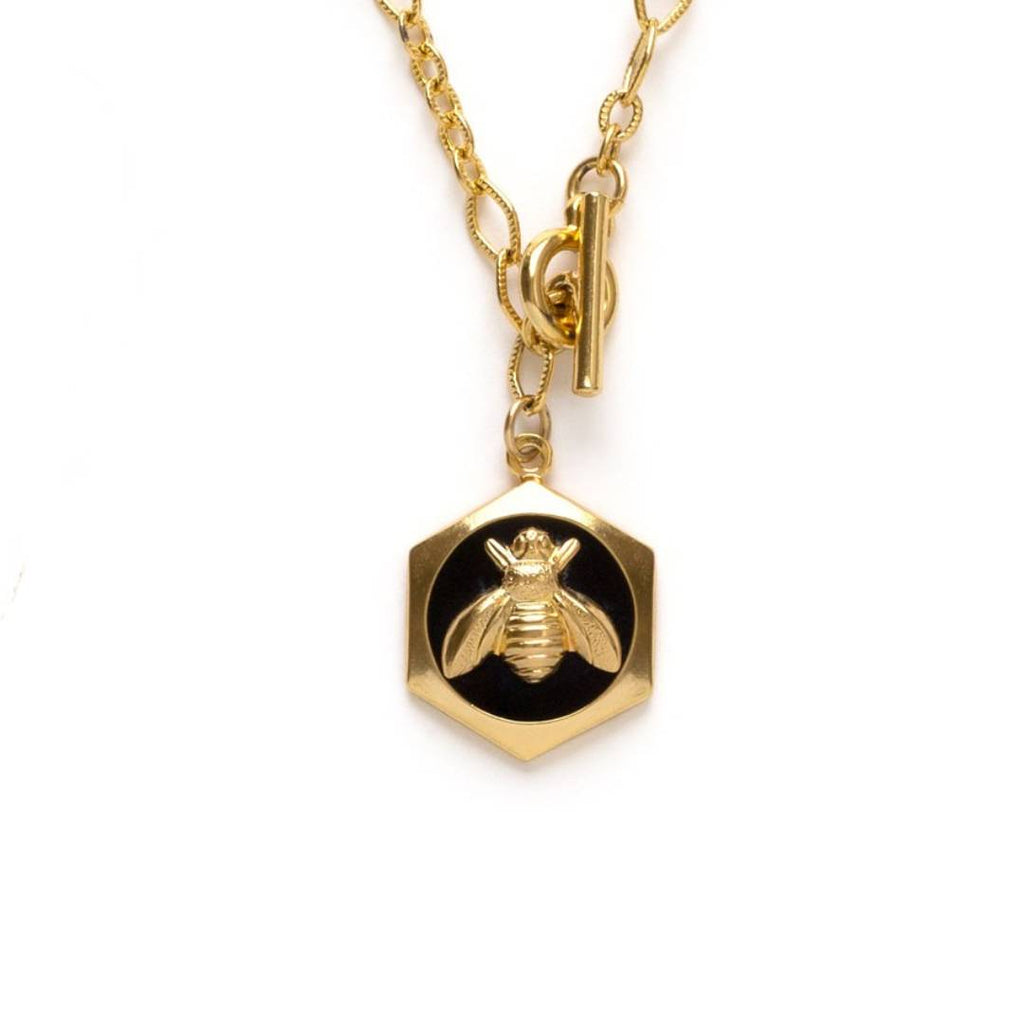 "Queen bee hexagon charm with black enamel on a 20"" chain with front toggle clasp"