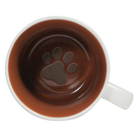 The inside of mug is brown and has a cat paw print at the bottom.