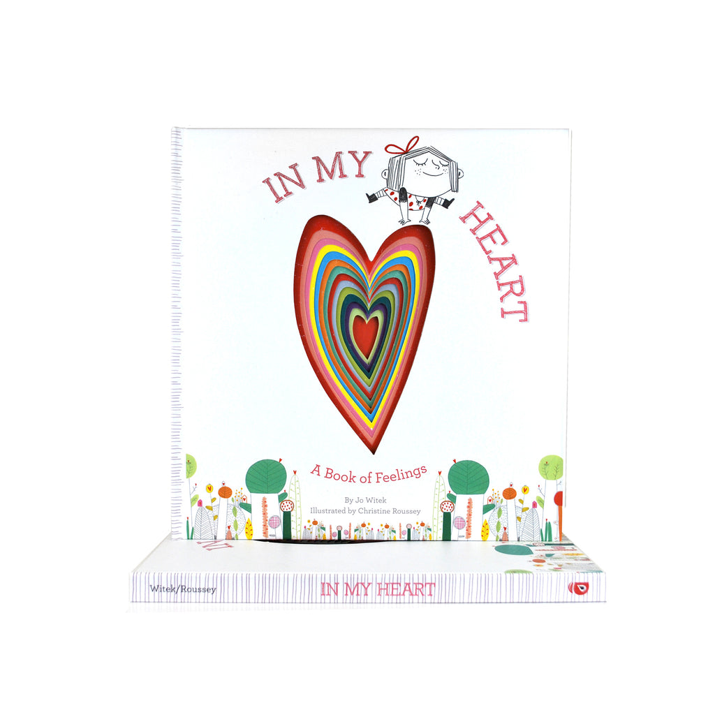 Cover features a multi-colored heart in the center. Title is on the top with a little girl jumping on top of the heart.