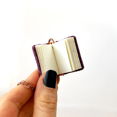 You can write on the paper the miniature books have