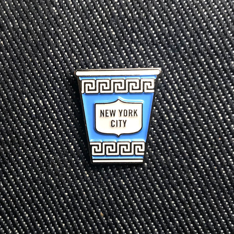 "Greek-themed, blue cup with text ""New York City"" in the center."