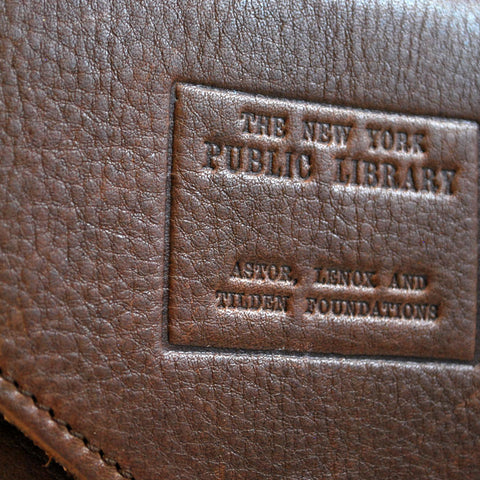 "Stamp is placed on the front flap. Text reads ""The new York Public Library"" and ""Astor, Lenox and Tilden Foundations"""