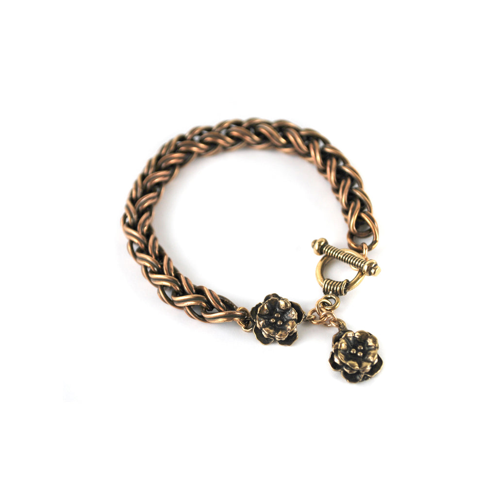 Bracelet with two rosettes pendents.