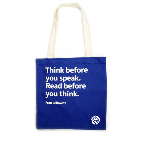 Quote on royal blue background tote bag with cream colored handles.