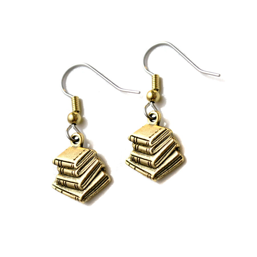 Earrings have a book stack as the pendant