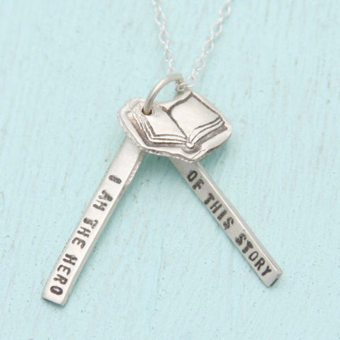It also has a open book charm hanging with the pendants