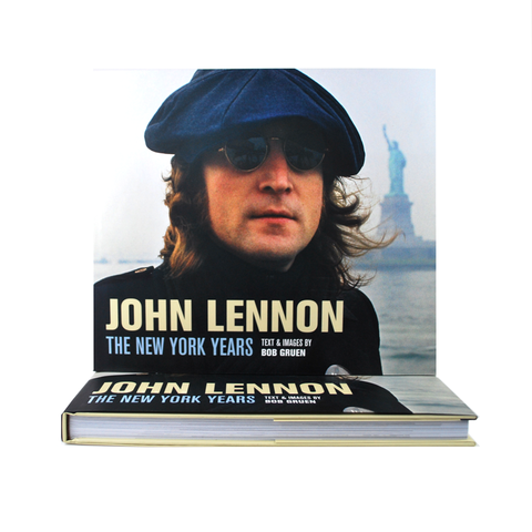 Cover features a photograph of John Lennon with the Statue of Liberty in the background.