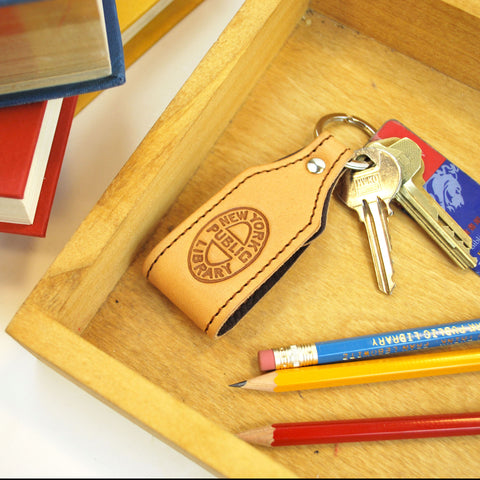 NYPL Bookbinding Stamp Key Chain - The New York Public Library Shop