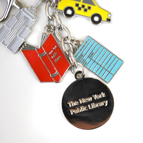 "Text ""The New York Public Library"" is on the reserve of the Library's lion logo charm"