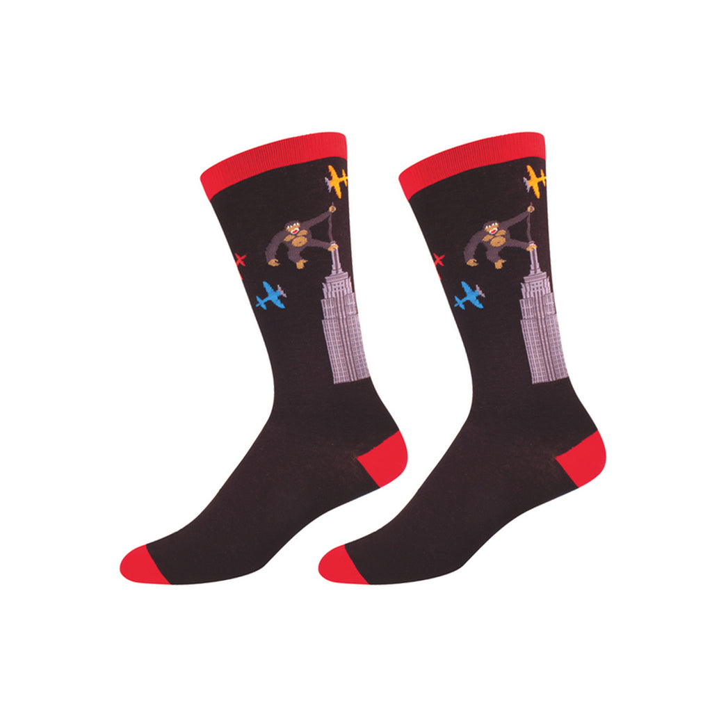 Cuff, short-row heel and toes are red. Rest of the sock is black. Illustration of King Kong on top of Empire State Building with three airplanes can be seen on leg area.