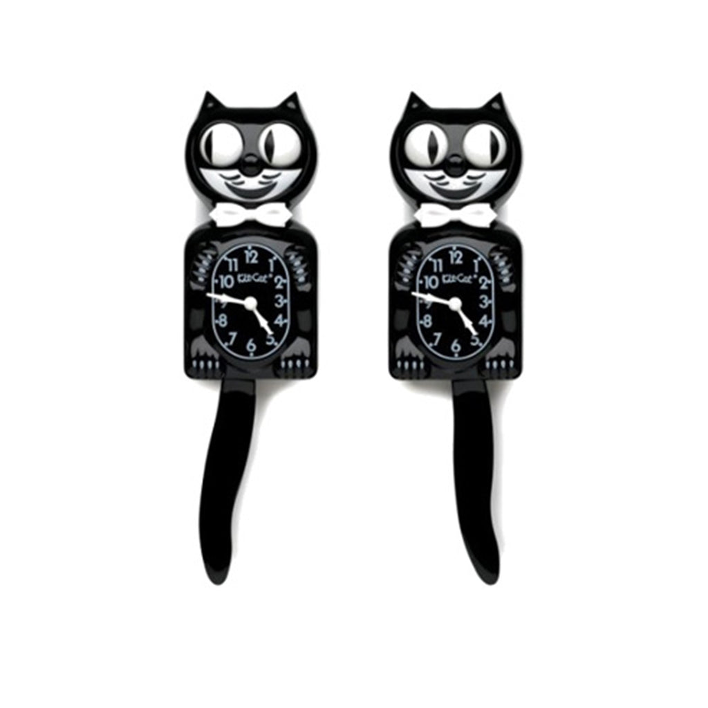 Black and white cat clocks. Cat also has a bow tie.