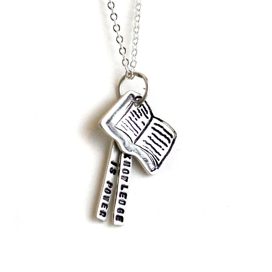 Necklace includes 3 charms: One of an open book, the other two are rectangular pieces with the quote on them.