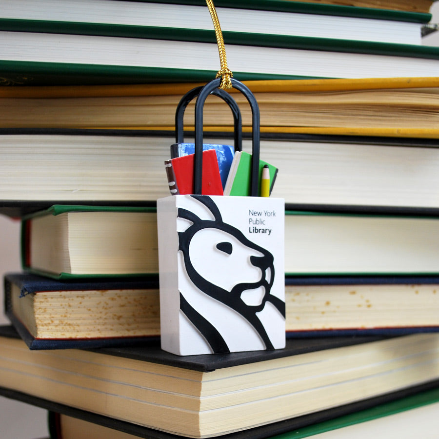 Ornament simulating the Library tote bag with some books and pencil inside of it. Black and white tote.
