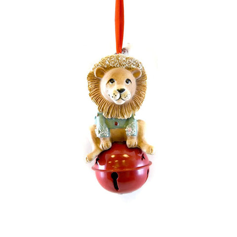 Ornament features a lion seating on a red bell. The bell does work.