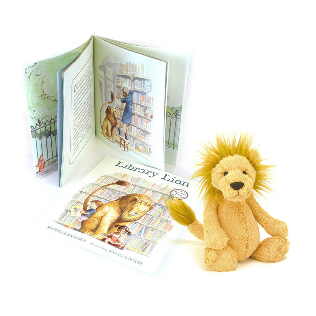 Photograph of plush with book to the side.