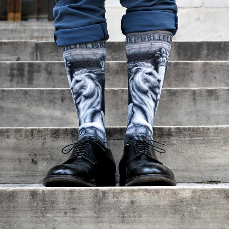 Gray socks with monochrome images of the library lions.
