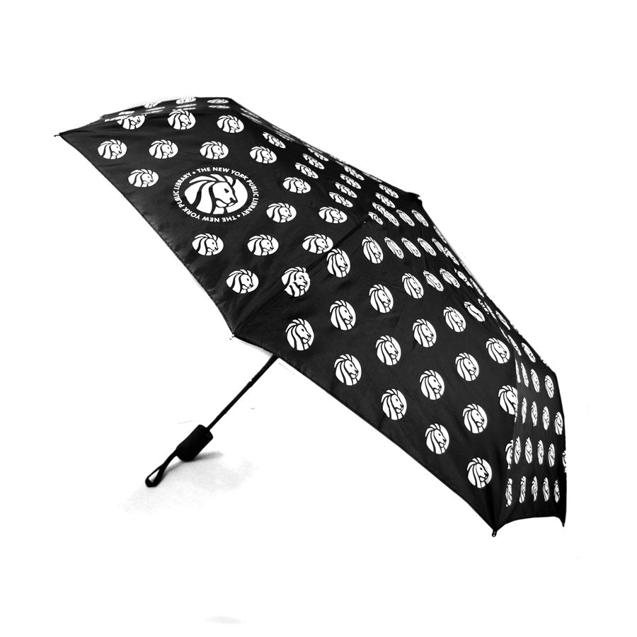 All black umbrella with repetitive library logo pattern.