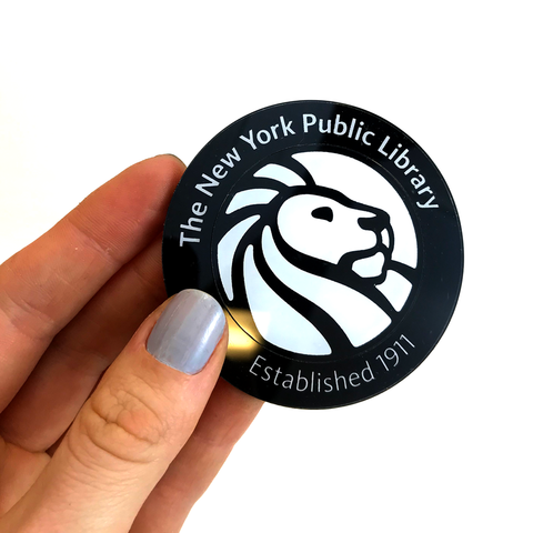 "Library Lion logo on black background with text ""The New York Public Library"" on top and text ""Established 1911"" at the bottom."