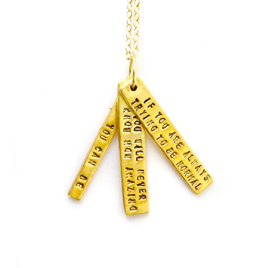 Necklace has three vermeil, thin, long pendants with quote in black.