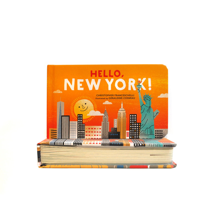 Cover features an illustration of NYC skyline, including the Statue of Liberty, on an orange background