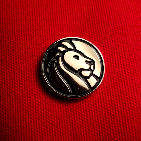 Library lion silhouette in black on silver background-circular pin. No text.