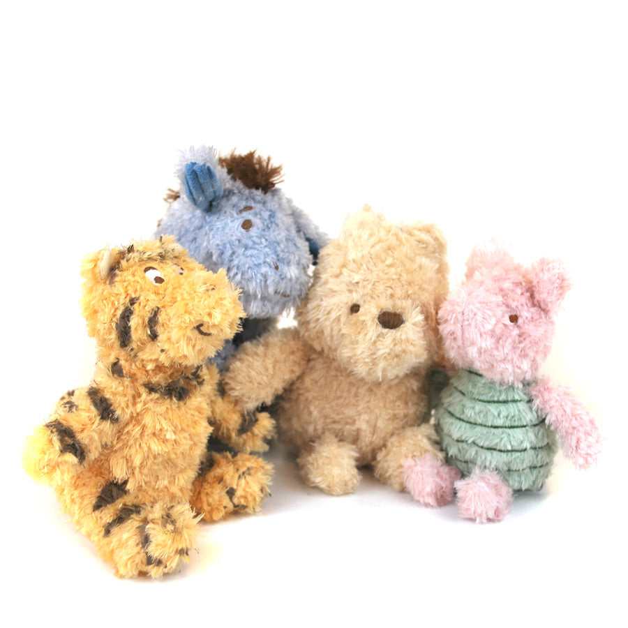 71f02ab7641f Four plush toys from the Winnie-the-Pooh collection