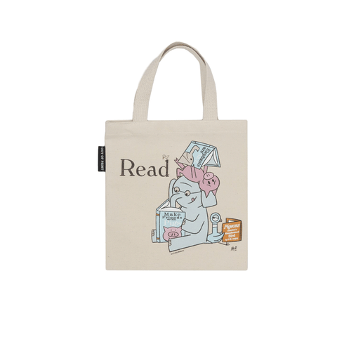 "Illustration of an elephant, a pig  on top of the elephant and a pigeon reading a book. Word ""read"" is on the top left area of the illustrations. Tote is light beige."