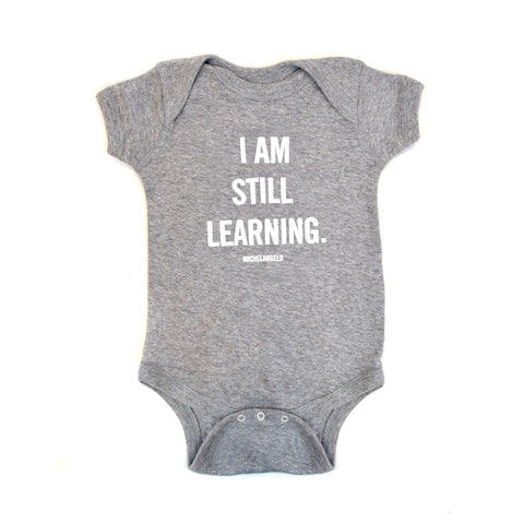 I am Still Learning NYPL Quote Onesie