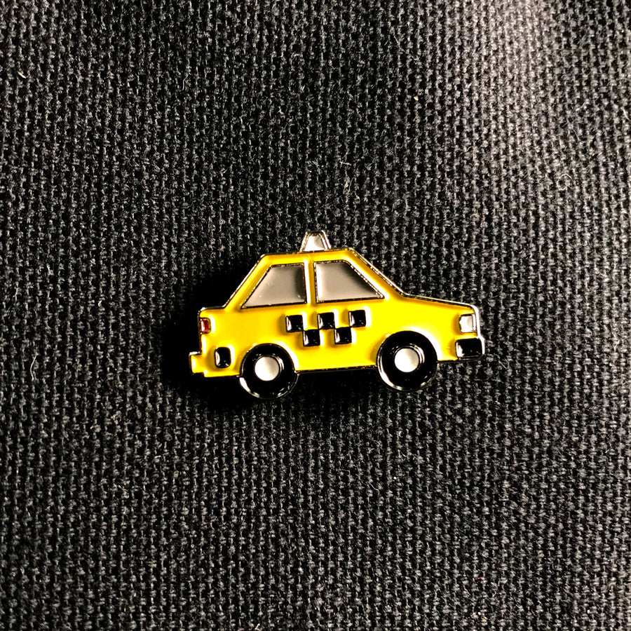 Side of a classic nyc taxicab. No text on the pin.