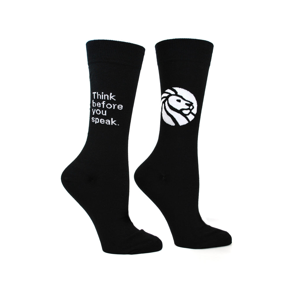"All black socks. One sock has ""Think before you speak."" and the library lion logo on reverse."