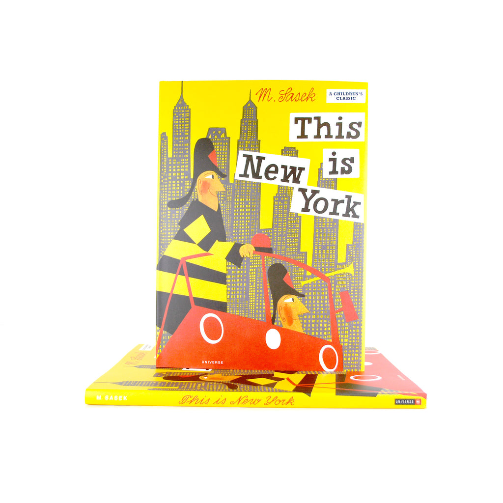 Cover features a cartoon illustration of two men on a red bus and the NYC skyline in the back.
