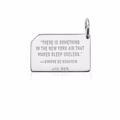 Quote on the reverse of the charm.