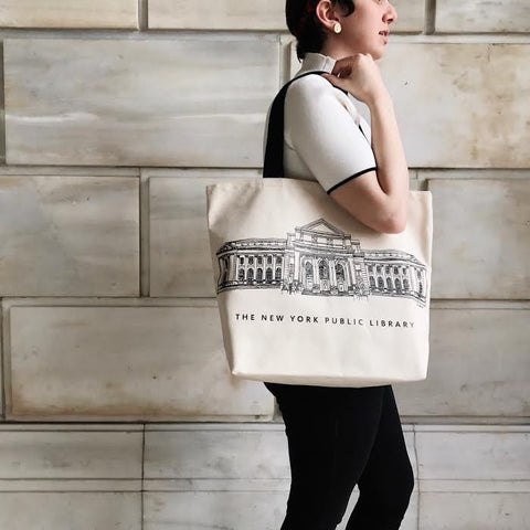"Sketch on light beige background tote with black handles. Text ""The New York Public Library"" at the bottom of the image."