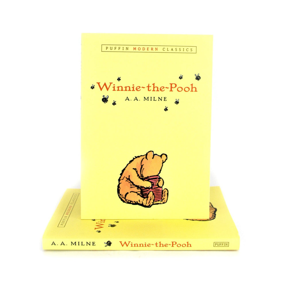 Cover features an illustration of Winnie The Pooh with his head inside the jar of honey on a yellow background. Title is on the top center area.